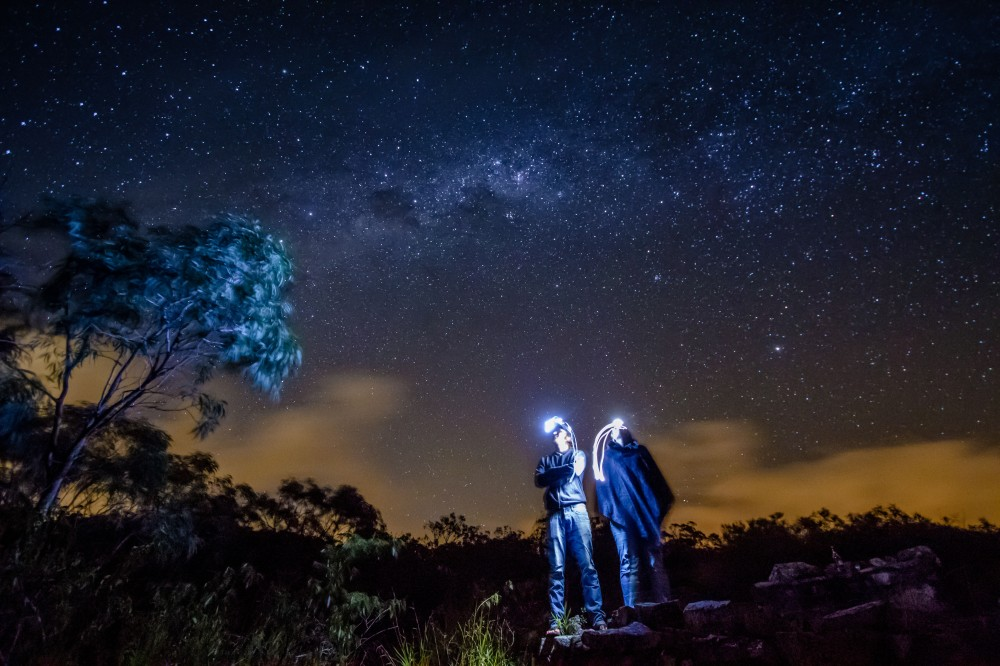 A winning shot for 2014 The North Face photo competition. Two star gazers admire the galaxy above. NSW, Australia.