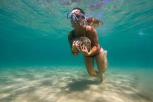 Underwater rock running with female athlete